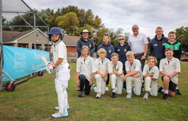 Swanage Cricket Club sponsored by Ellis Jones solicitors, youth team members are pictured with club officials and Ellis Jones managing partner Nigel Smith, who is fourth from the left on the back row.