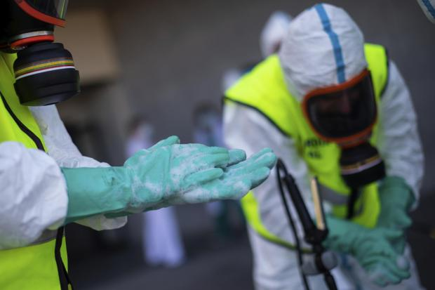 Spanish Royal Guard soldiers during disinfection work at a hospital to prevent the spread of coronavirus