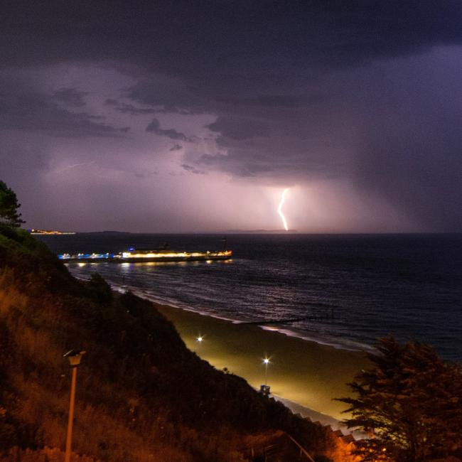 Lightning behind Bournemouth Pier by Echo Camera Club member Simon Bond.