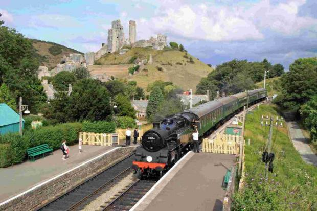 Swanage and Wareham Voice: A steam train at Corfe Castle on the Swanage Railway