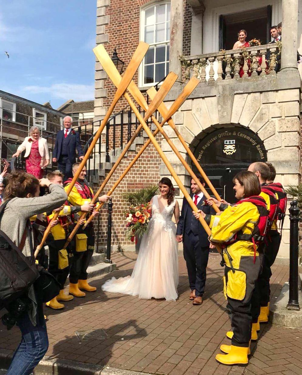 Raising the oars at the wedding in Poole