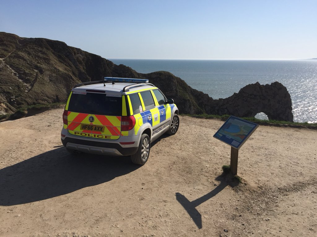 A police car attends the incident at Durdle Door Picture: Roan Doyle