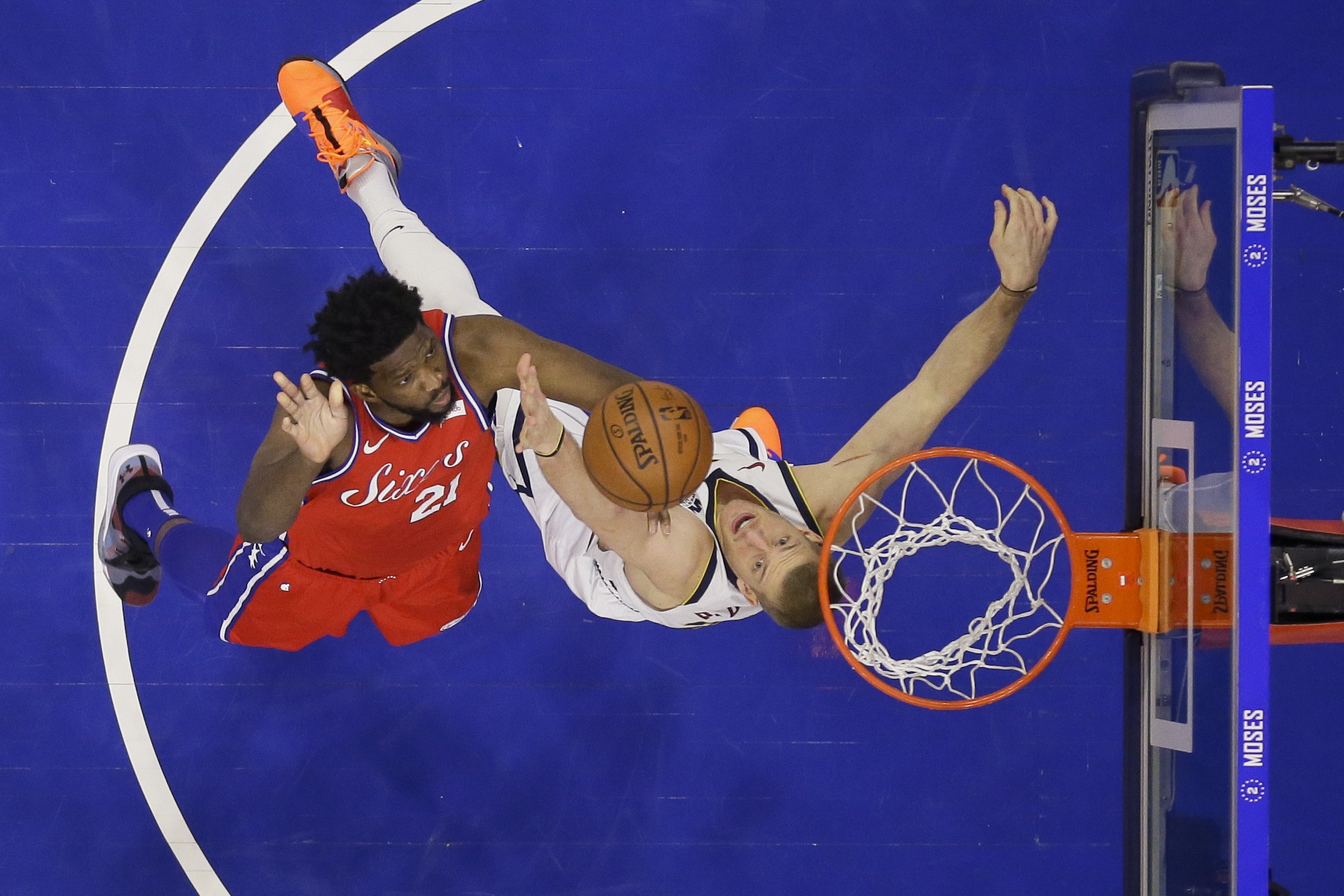 Joel Embiid, left, had a fine night for the 76ers